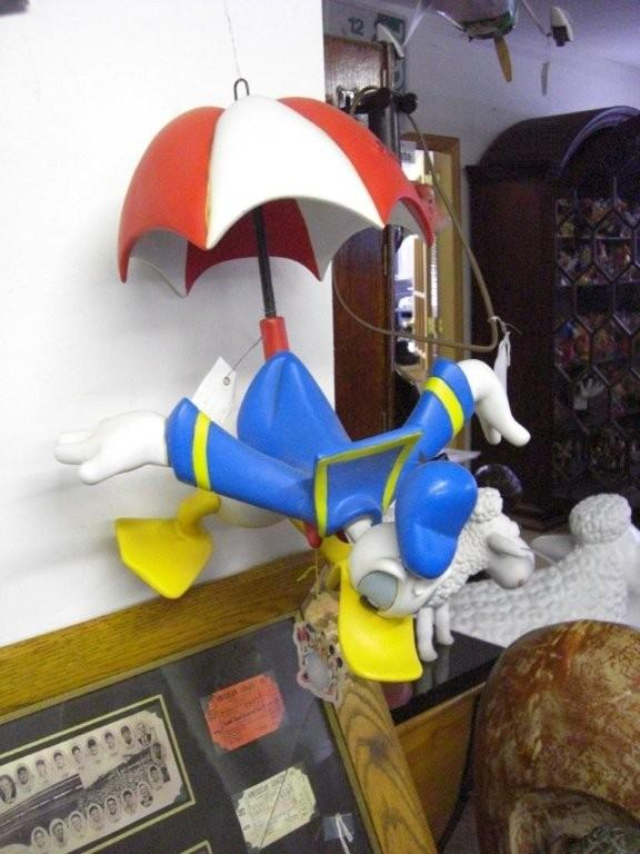 Donald Duck parachuting with umbrella